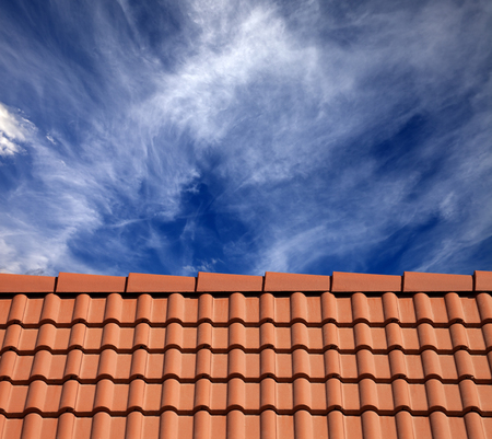 Roof tiles and sky with clouds at sun day photo