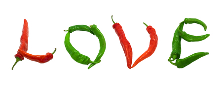 Love text composed of red and green chili peppers. Isolated on white . photo