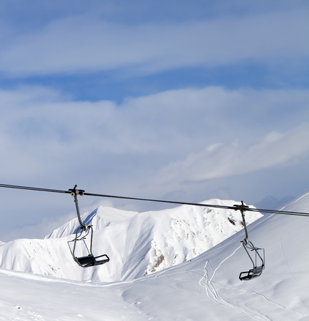 chairlift: Chair lift at ski resort in sun day at Caucasus Mountains, Georgia Stock Photo