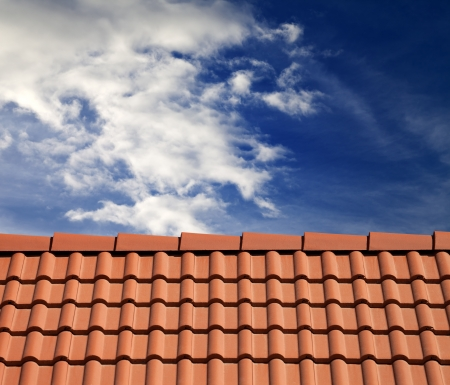 roof tiles: Roof tiles and sky with clouds at sunny day