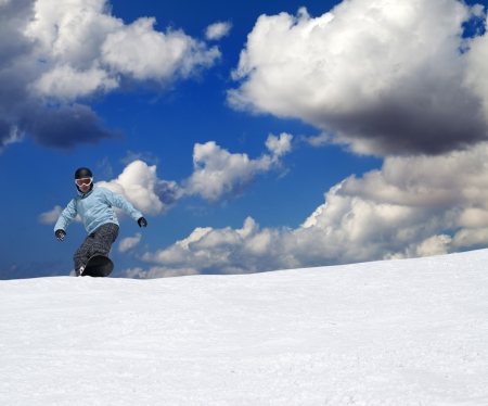 offpiste: Snowboarder on off-piste slope at nice sun day Stock Photo