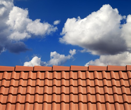 roof tiles: Roof tiles and cloudy sky at nice sun day Stock Photo