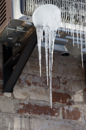 cold air: Icicle on icy air conditioner