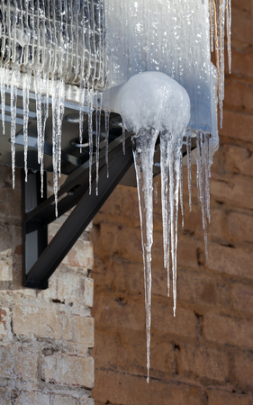 Icicle on icy air conditioning. Close-up view. photo