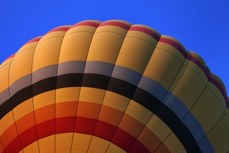 Hot air balloon on blue sky. Close-up view. photo