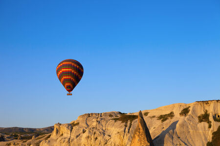 Hot air balloon in early morning. Turkey, Cappadocia, Goreme. photo
