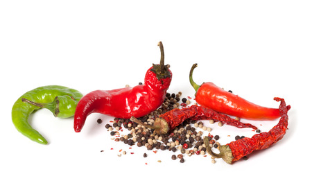 Various of hot peppers on white background photo
