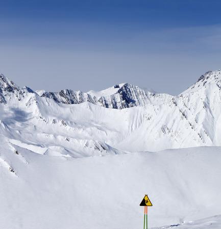 Warning sing on ski slope. Caucasus Mountains, Georgia, Gudauri photo