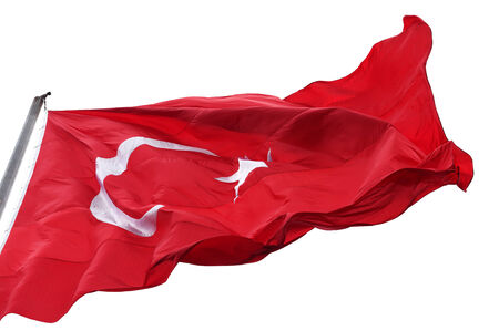 Turkish flag waving in wind. Isolated on white background. Stock Photo