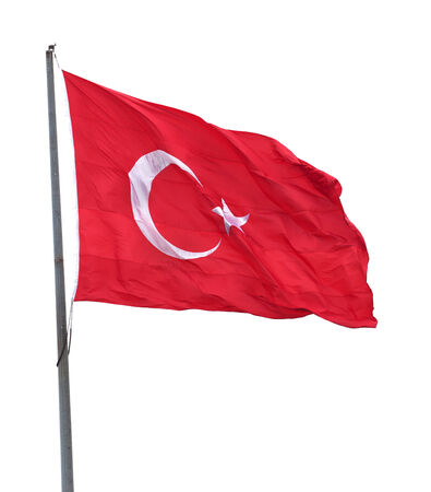 Turkish flag on flagpole waving in wind. Isolated on white background. Stock Photo