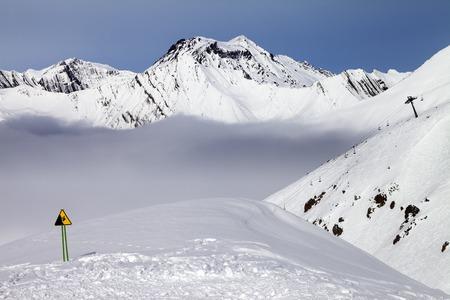 Warning sing on ski slope. Caucasus Mountains, Georgia, ski resort Gudauri. photo