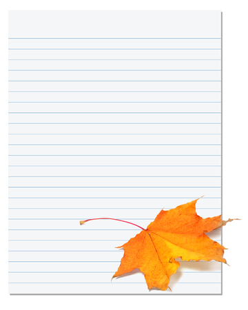 college ruled: Notebook paper with autumn maple leaf on white. Back to school background