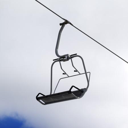 Chair-lift and cloudy sky. Caucasus Mountains, Georgia, ski resort Gudauri. Close-up view. photo
