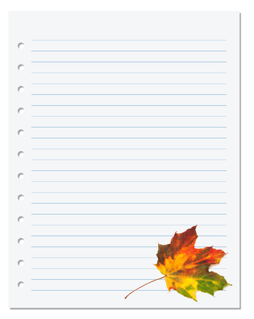 Notebook paper with  multicolor autumn maple leaf on white. Back to school background photo