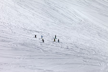 off piste: Snowboarders and skiers on off piste slope. Caucasus Mountains, Georgia, ski resort Gudauri. Stock Photo