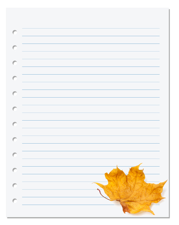 Notebook paper with autumn dry maple leaf on white. Back to school background photo