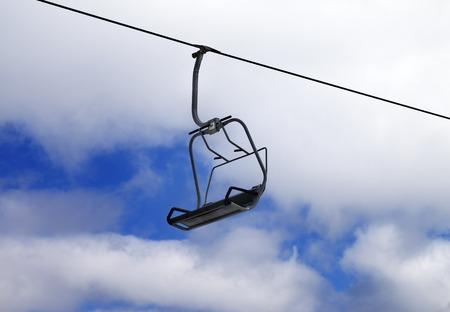Chair-lift and cloudy sky. Caucasus Mountains, Georgia, ski resort Gudauri. photo