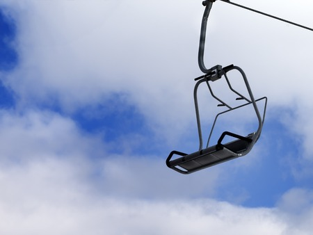 skyway: Chair-lift and blue sky with clouds. Caucasus Mountains, Georgia, ski resort Gudauri. Stock Photo