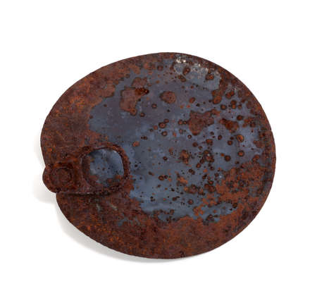 Old rusty cap of tin can isolated on white background photo