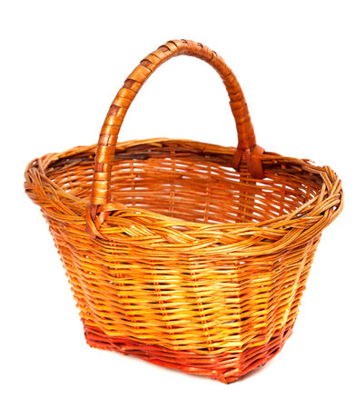 osier: Empty wicker basket. Isolated on white background. Close-up view.