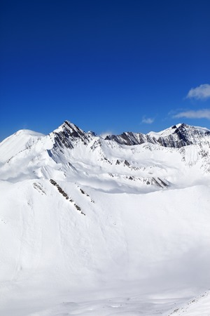 off piste: Winter snowy mountains at nice day.