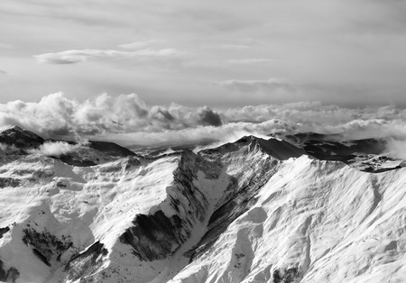 Black and white winter mountains in mist.  photo