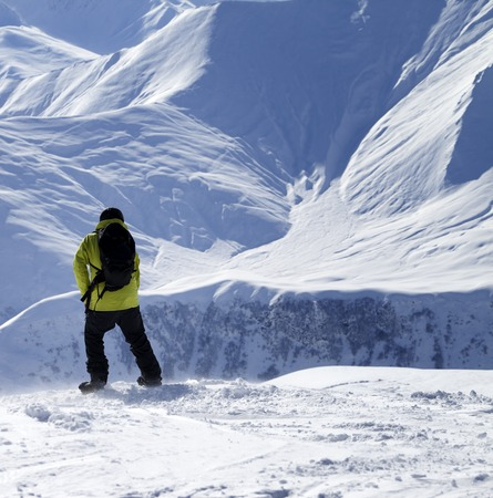 off piste: Snowboarder on top of off-piste slope at windy day. Stock Photo