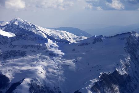 offpiste: Off-piste slope at evening. Caucasus Mountains, Georgia, ski resort Gudauri. Stock Photo