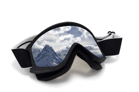Ski goggles with reflection of snow mountains. Isolated on white background photo