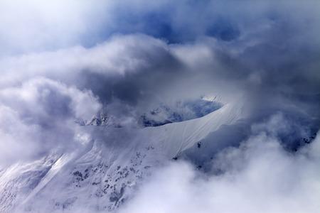 offpiste: Off-piste slope in sunlight multicolor clouds. Caucasus Mountains, Georgia, ski resort Gudauri.