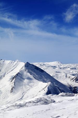 piste: Snowy mountains at sunny day. Caucasus Mountains, Georgia, ski resort Gudauri. Stock Photo