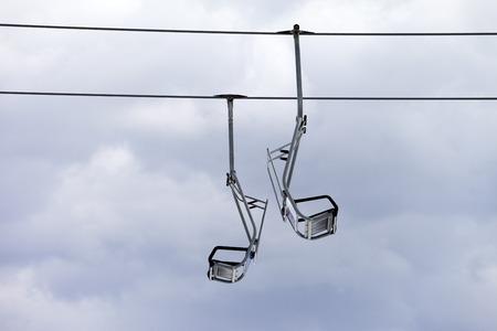 Chair-lift and overcast sky. Caucasus Mountains, Georgia, ski resort Gudauri. photo