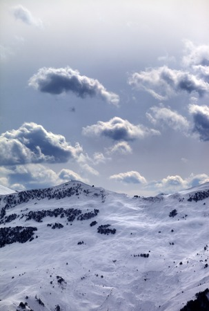 offpiste: Off-piste slope and sunlight clouds. Caucasus Mountains, Georgia, ski resort Gudauri.