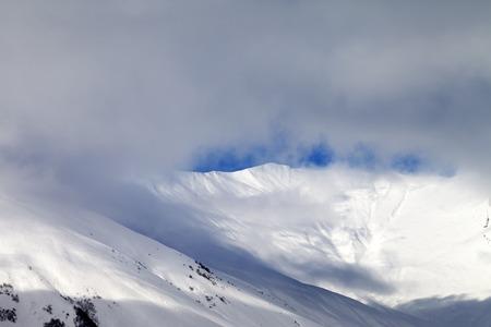 offpiste: View on off-piste slope in mist. Caucasus Mountains, Georgia, ski resort Gudauri.