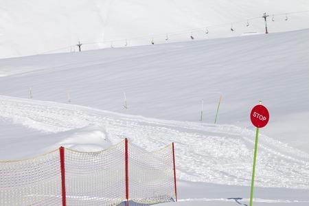 Closed ski slope with stop sign. Caucasus Mountains, Georgia, ski resort Gudauri. photo