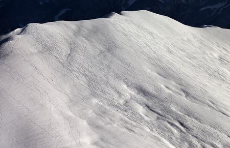 offpiste: View on off-piste slope at sunny evening. Caucasus Mountains, Georgia, ski resort Gudauri.