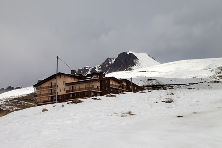 off piste: Hotel and ski slope in gray day. Caucasus Mountains, Georgia. Ski resort Gudauri.