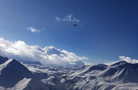 heli: Helicopter above snowy plateau. Caucasus Mountains, Georgia. Ski resort Gudauri.
