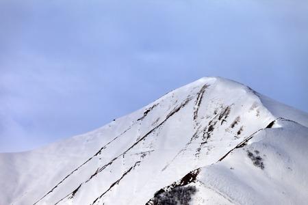 offpiste: Off-piste snowy slope in morning. Caucasus Mountains, Georgia, ski resort Gudauri.