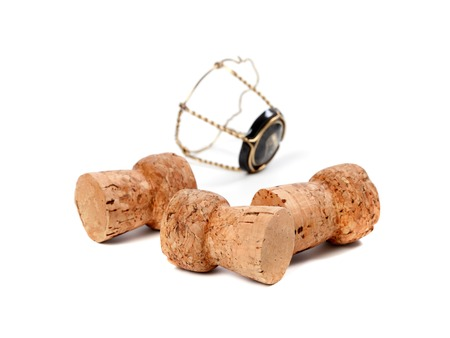 Three corks from champagne wine and muselet isolated on white background. Selective focus. photo