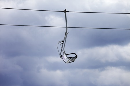 Chair-lift and overcast gray sky photo