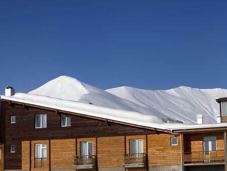 Hotel in snow at winter mountains. Caucasus Mountains, Georgia, ski resort Gudauri. photo