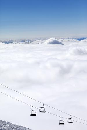 Mountains under clouds and chair-lift. Caucasus Mountains, Georgia. Ski resort  Gudauri. photo