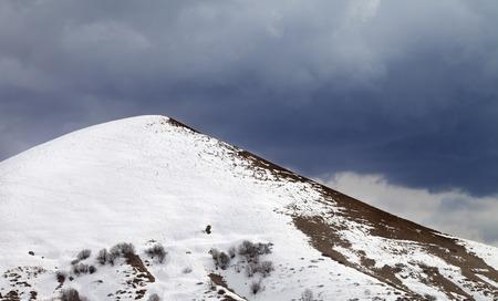 offpiste: Off-piste slope and overcast gray sky. Caucasus Mountains, Georgia, ski resort Gudauri.