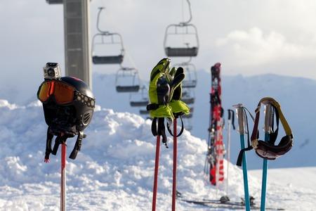 Protective sports equipment on ski poles at ski resort at sunny day photo