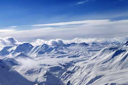 Snow plateau and sky with clouds. Caucasus Mountains, Georgia. View from ski resort Gudauri. photo