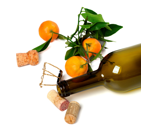 Empty bottle of wine, corks, muselet and mandarins. Isolated on white background. photo