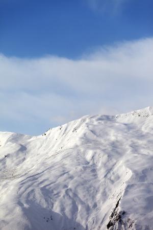 offpiste: Off-piste slope in nice day. Caucasus Mountains, Georgia, ski resort Gudauri. Stock Photo