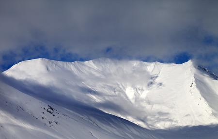 offpiste: View on sunlight off-piste slope in mist. Caucasus Mountains, Georgia, ski resort Gudauri. Stock Photo