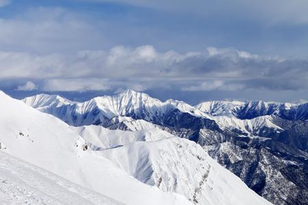 offpiste: Off-piste slope and snowy mountains. Caucasus Mountains, Georgia, ski resort Gudauri.